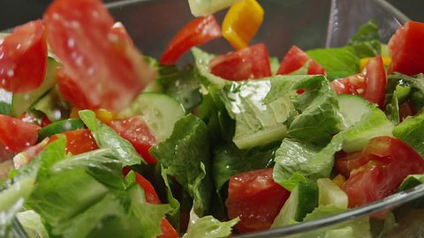 Salad preparation process. Process of mixing fresh salad. Shot on RED EPIC DRAGON Cinema Camera.