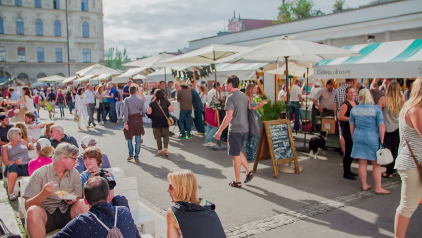 EVENTS IN LJUBLJANA JULIJ-AVGUST 2016 A lot of people have come to the food market called Open Kitchen and they are enjoying their lunch and meet their friends on a Friday afternoon. It is summer time