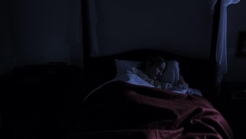 VIRGINIA   SUMMER 2016   Reenactment  Recreation    Sleeping woman in dark  bedroom of. Man Playing Guitar With Moonlight At Home Backlit Silhouette