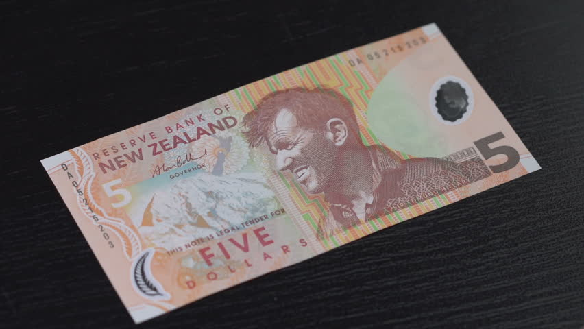 New Zealand Dollar counted on a table