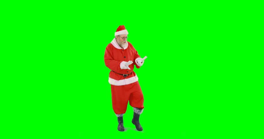 Happy santa claus dancing against green background 4k #21263902
