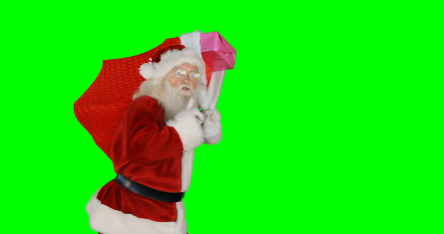 Santa claus carrying gifts in sack during christmas time on green background 4k