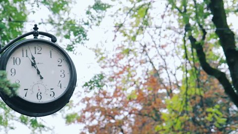 Street clock. Vintage street clock. Spring street clock