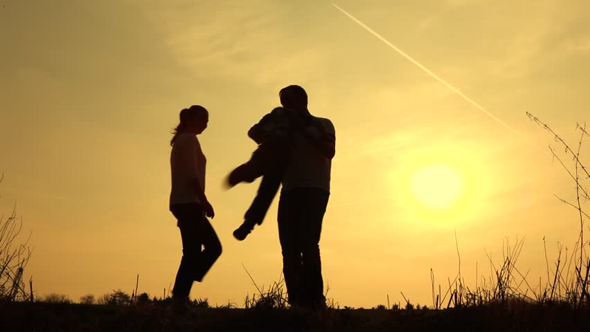 father and son having fun silhouetted