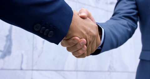 Slow-Mo Close-Up Of Standard Business Man Suit Handshake With Hands In Focus