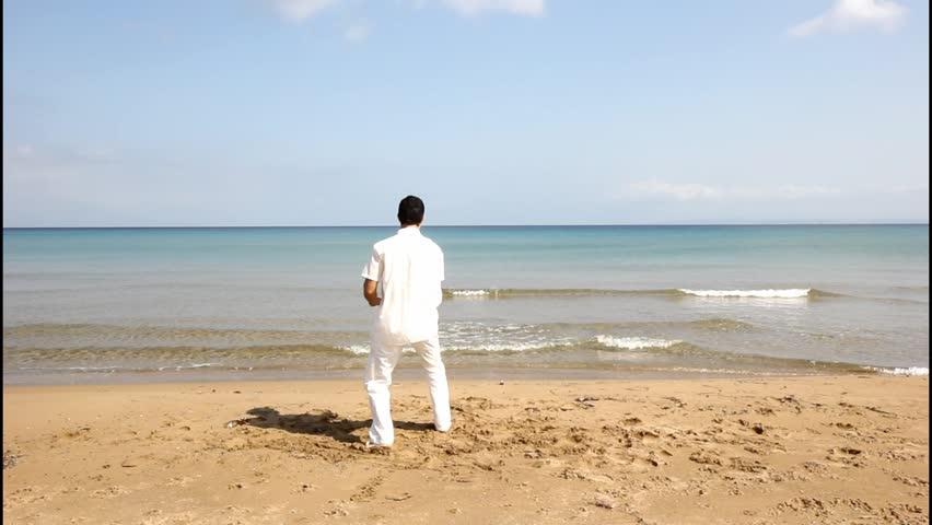 Man Walking On The Beach, , Camera Stabilizer Shot Stock Footage ...