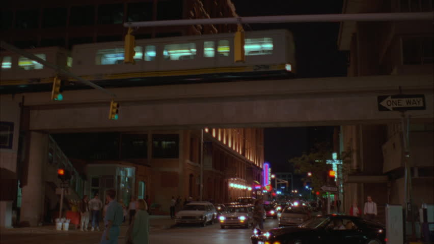 Night ND city street then tilts up people mover train | Shutterstock HD Video #21320752