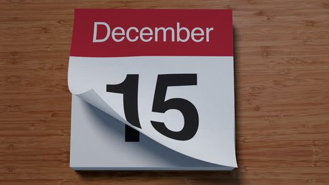 Calendar for December on wooden table flipping through days of month