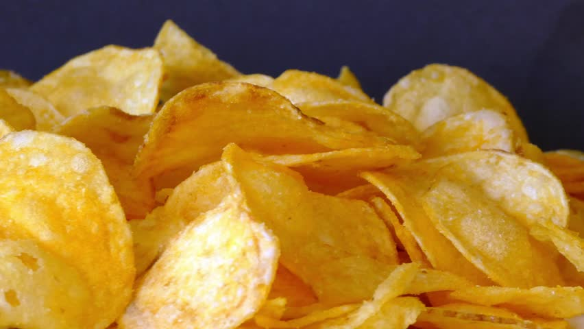 Rotating potato chips | Shutterstock HD Video #21352444