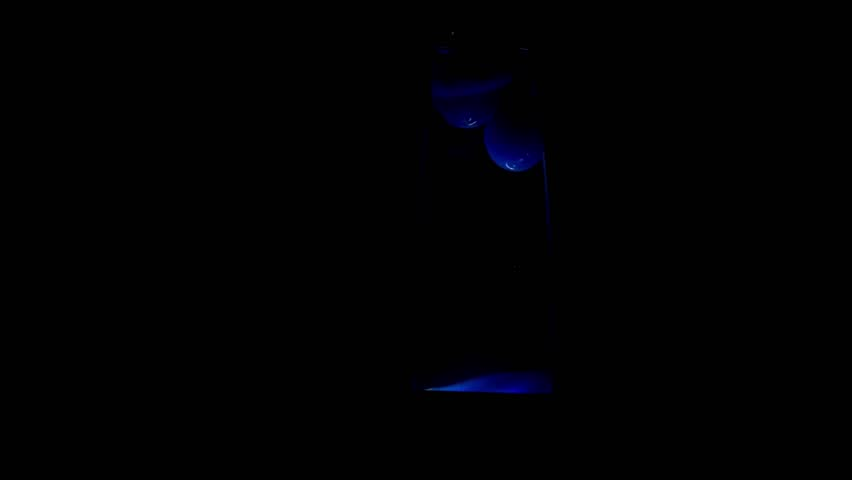 Lava lamp of deep-blue color in the dark for background.   Shutterstock HD Video #21353302