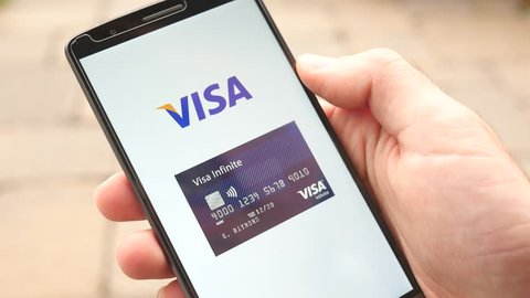 MONTREAL, CANADA - November 2016 : Credit Card payment companies logo being swipe on smartphone screen : Mastercard, Visa, American Express, Discover  Great concept for ecommerce shopping.