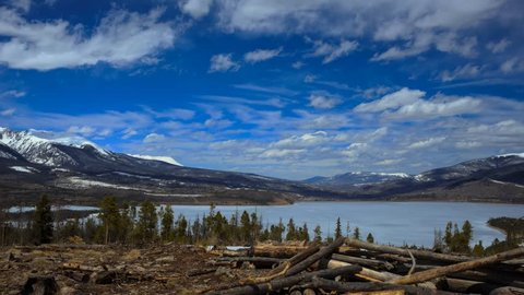 Kelvin–Helmholtz clouds timelapse over Frozen Lake with Snow capped mountains