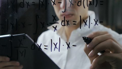 scientist wrote mathematical formulas on a blackboard