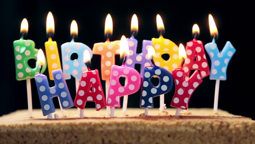 Lighted Candles On A Happy Birthday Cake Candles With The