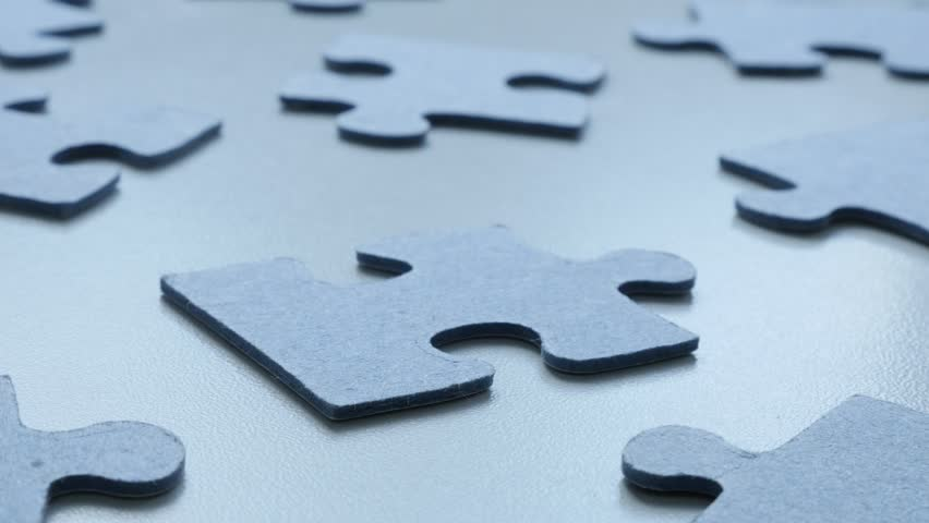 Slow tilt on problem solving game pieces 4K 2160p 30fps UHD  footage - Blue jigsaw puzzle on the table shallow DOF 3840X2160 UltraHD tilting video