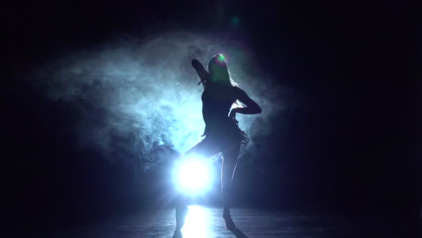 Samba, rumba, cha-cha-cha in the studio, silhouette. Slow motion