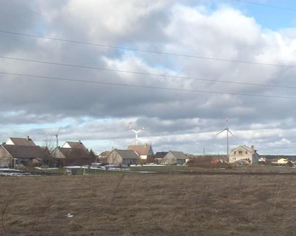 Windmills Between Residential Buildings Alternative Stock Footage