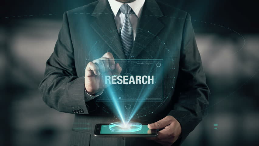 Businessman with Research concept choose from Insight Strategy Social Planning Brand using digital tablet | Shutterstock HD Video #21477322