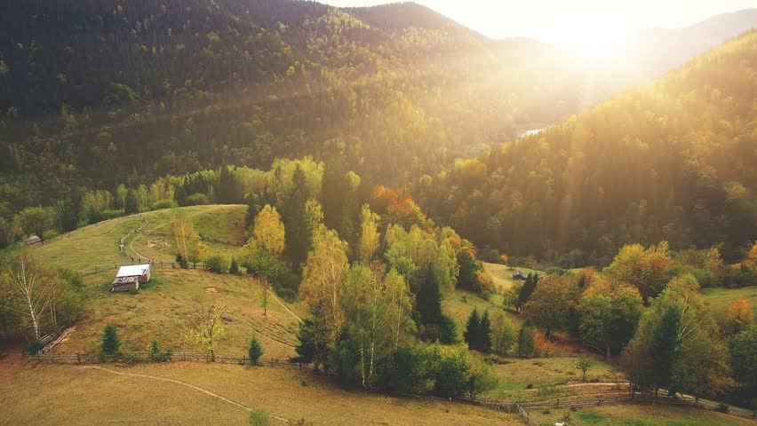 Aerial Drone Footage View: Flight over autumn mountain village with forests, fields and river in sunrise soft light. Carpathian Mountains, Ukraine, Europe. Majestic landscape. Beauty world. 4K | Shutterstock Video #21477811