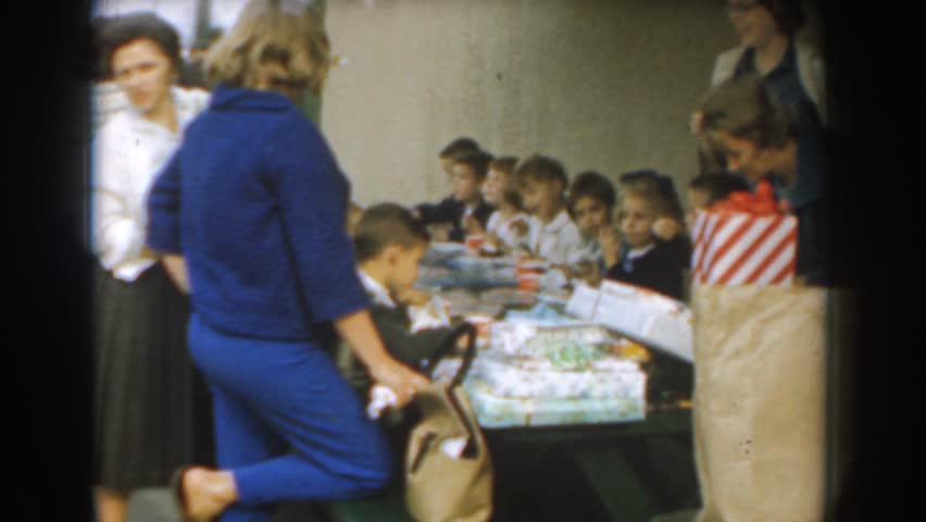LOS ANGELES, CALIFORNIA 1961: the whole family gathered around for a birthday party | Shutterstock HD Video #21517042