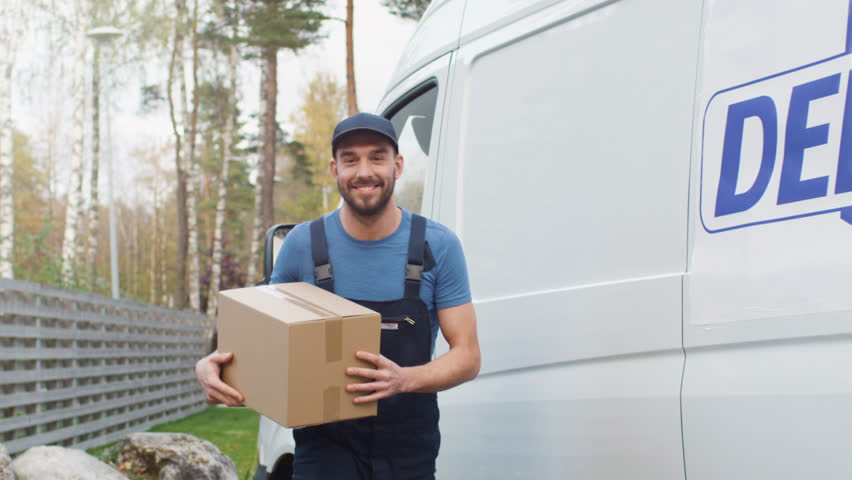Smiling Delivery Man Comes Out of His Cargo Van with Cardboard Boxes and Goes Towards Camera. Shot on RED Cinema Camera in 4K (UHD). | Shutterstock HD Video #21531502