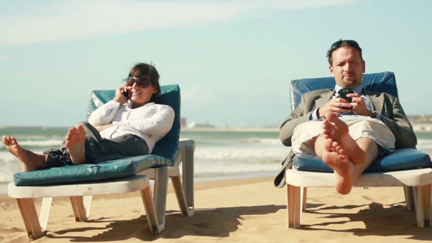 Business people with cellphones on vacations