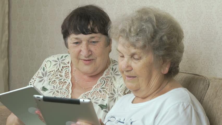 Old women holding the silver digital tablets | Shutterstock HD Video #21582952
