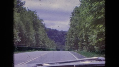 NIAGARA FALLS NEW YORK 1964: car driving down paved road in the woods