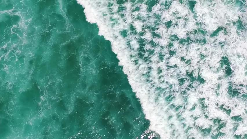 Uluwatu. Surfers surfing in ocean. Number four surf destination in the world for surfers of all abilities. Aerial top view. Bali, Indonesia