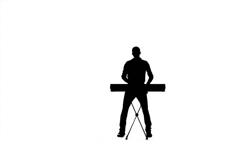 Silhouette Of A Man Playing The Piano. Slow Motion Stock ...