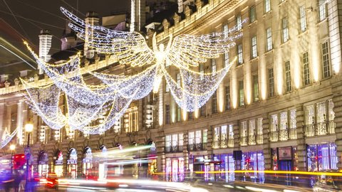 London, UK - 23.11.2016: Hyper-Lapse at the curve of Regent Street at the Piccadilly Circus, London. Time-Lapse, night, Christmas decoration. Long shutter speed, wide angle.