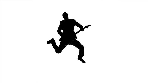 Guitarist playing on bass guitar jumps. Slow motion. Silhouette