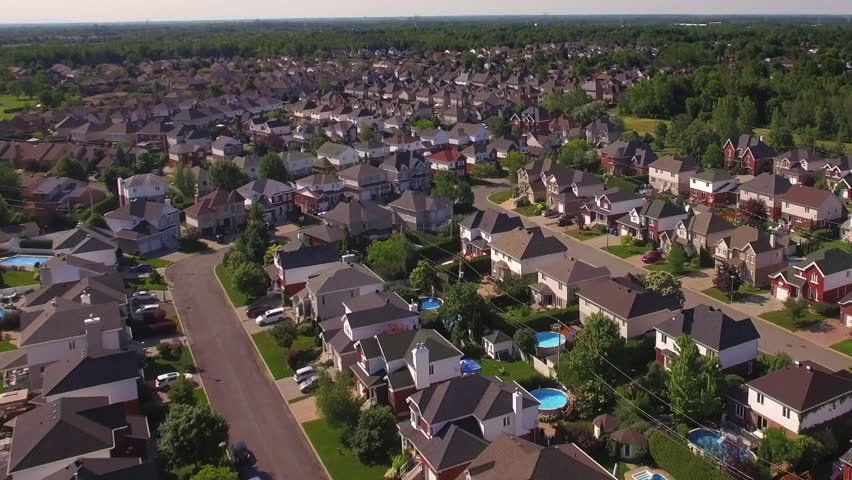 Aerial view of residential neighborhood in the suburbs of Montreal at sunset in Quebec, Canada. | Shutterstock HD Video #21702376