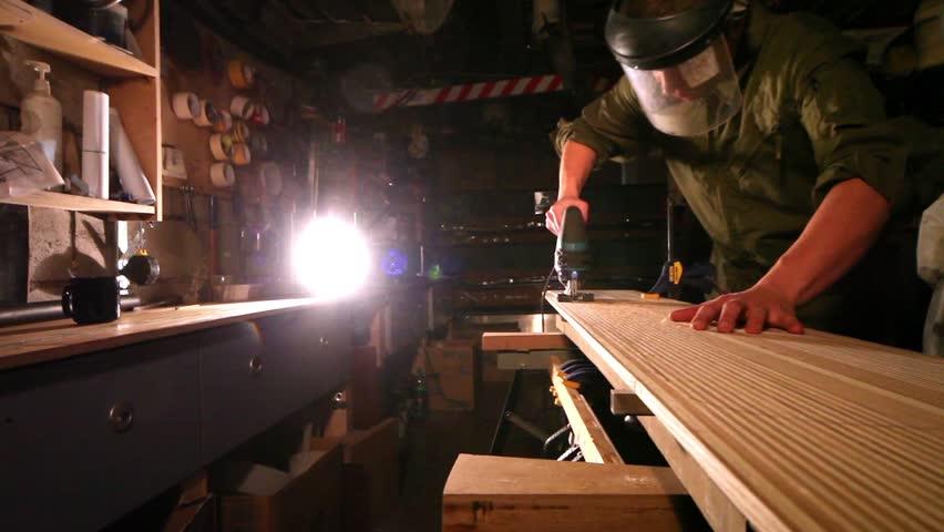 Workman in joinery workshop.