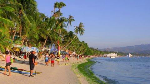 PHILIPPINES, BORACAY ISLAND - APRIL 2015: Crowds Of Tourists Walking On White Beach; Boracay Island Philippines