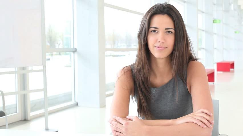 Portrait of businesswoman talking to camera
