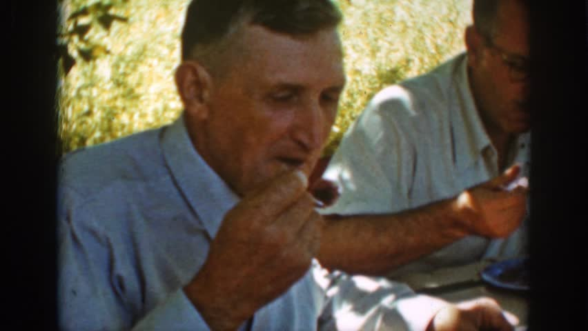 AUBURN CALIFORNIA 1939: funny old men having delicious food served on the table