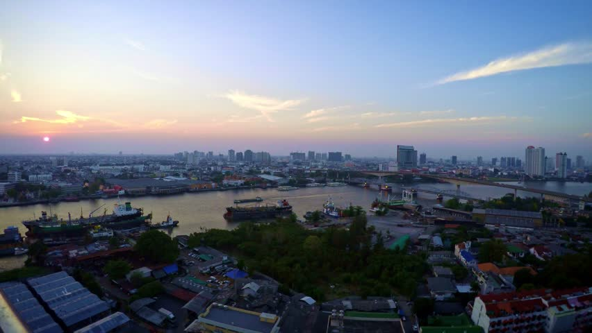 4K Timelapse Aerial View of Harbor and Street with Traffic Cityscape Bangkok. Timelapsed of sunset in the river with ships and bridge at Thailand from the Day to the night.-Dan | Shutterstock HD Video #21740932