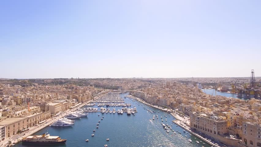 Aerial Footage Of Harbor And City Against Blue Sky Drone Boat Malta Mediterranean Travel Marine History Fort Scenic Architecture