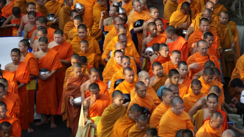 BANGKOK, MARCH 17, 2012: Monks are participating in a Mass Alms Giving of 12,600 monks for the Makha Bucha celebrations in Bangkok, Thailand on March 17, 2012.