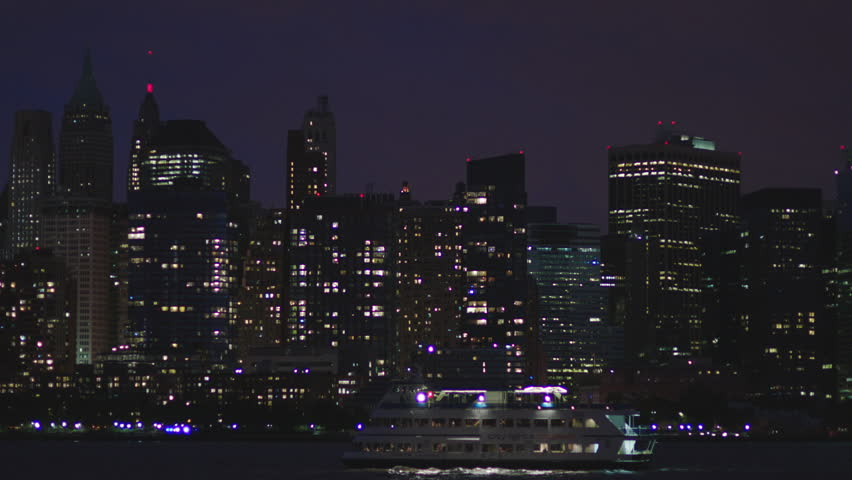 Hd00:24DUSK Night Wide Across Water From New Jersey Pan Left Over New York  Rake City NYC Skyline, 2 Buildings Under Construction City Lights Cruises  Tour ...