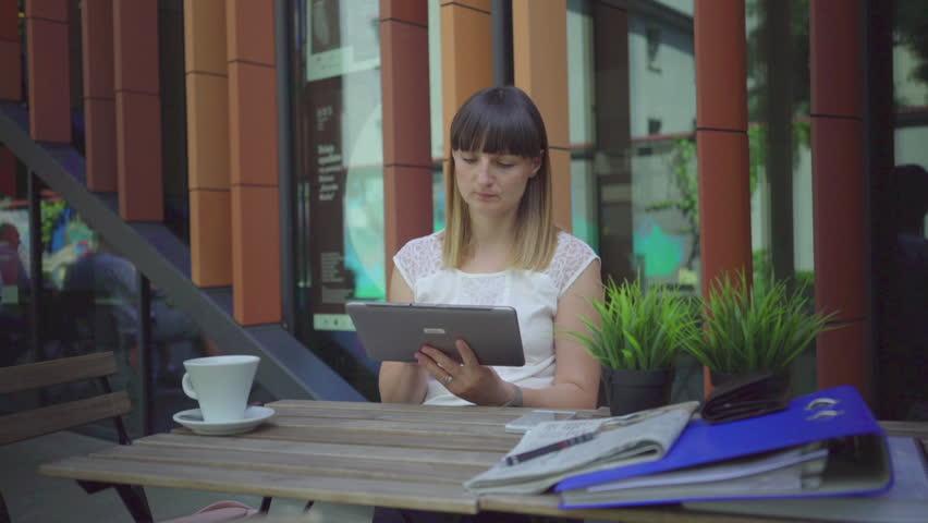 Businesswoman working with tablet. Outdoor. Steadycam shot. | Shutterstock HD Video #21783226