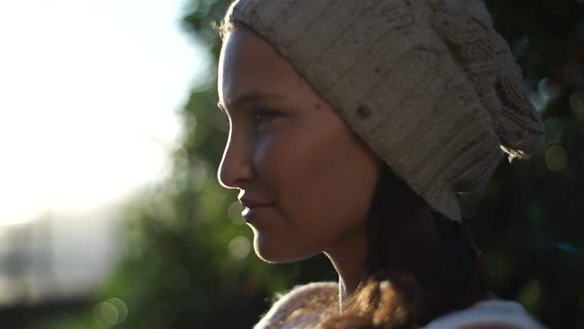 An young and beautiful woman walk on a sidewalk through beach | Shutterstock HD Video #21802822
