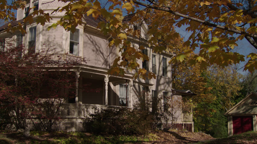 Day tilt tree right side beige wood clapboard house , wrap around porch, bay windows, dormers, turret, autumn, fall trees, back porch, detached garage, (Oct 2012)