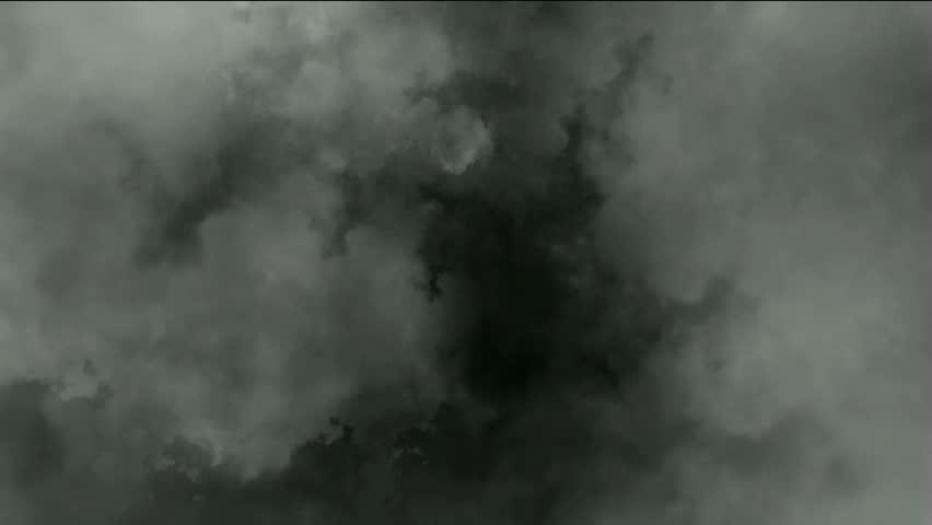 Dark clouds & smoke slowly flying,pollution gas.