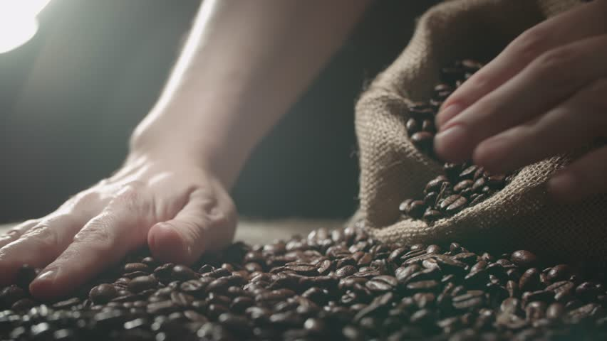 Human hands to touch high-quality coffee beans to scatter, bag jute, slow motion | Shutterstock HD Video #21886162
