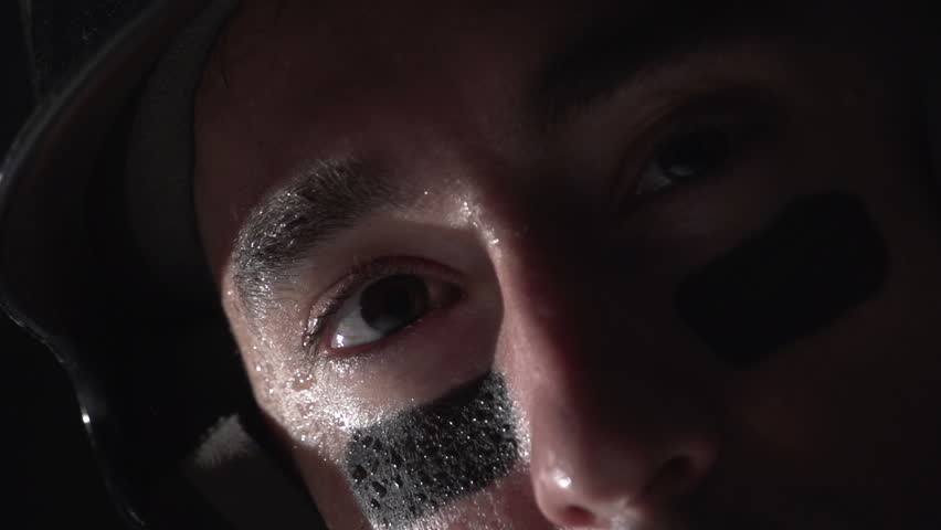 Close up of a baseball players eyes as he bats