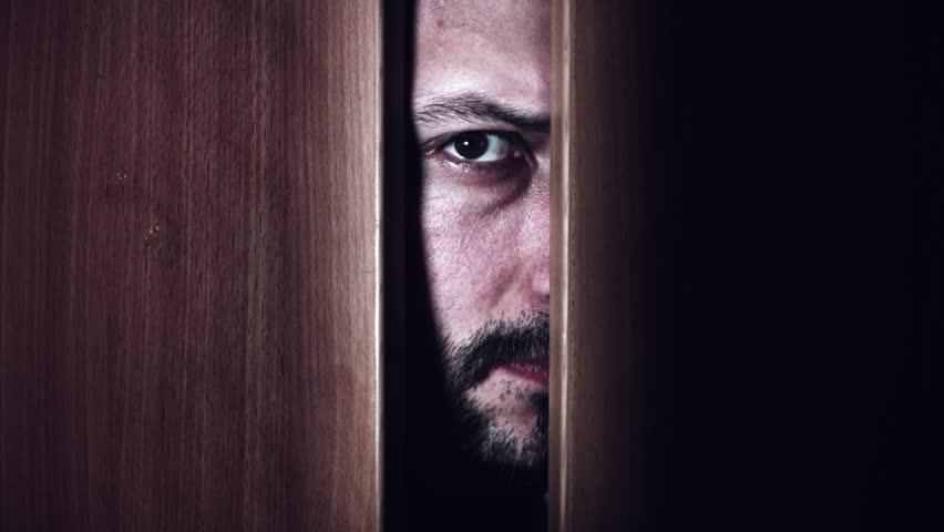 looking out door. 4K Thriller Man Eye Looking In Door Gap, Zoom Out Stock Footage Video 21910612 | Shutterstock