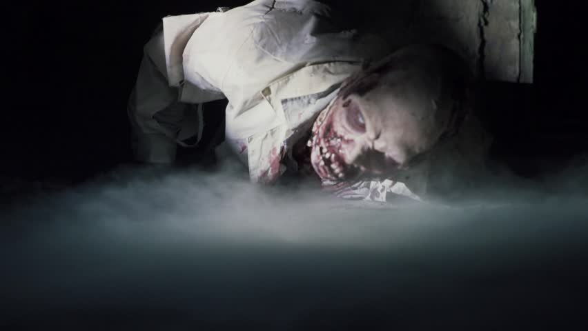 Horror scene of a scrambling dead zombie, halloween