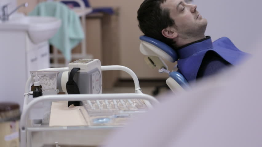Female dentist makes teeth X-rays to the male patient | Shutterstock HD Video #21973966